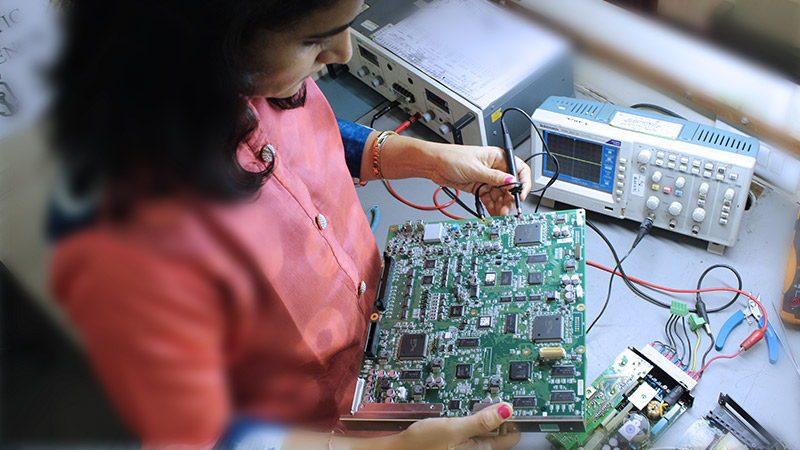 Female Engineer at Moloobhoys PCB Repair Facility, working on the circuit board